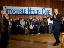 Obama-affordable-health-care-sign-428